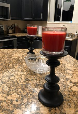 2 black wooden candle sticks with 2 candles for Sale in Chandler, AZ