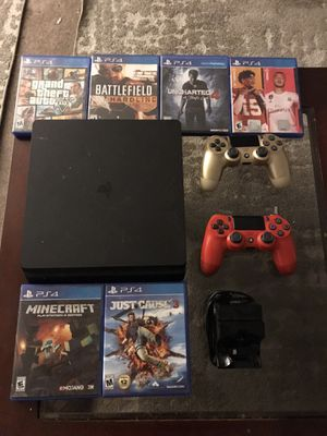 Ps4 with games and two controllers with a wireless charger good condition for Sale in Tracy, CA
