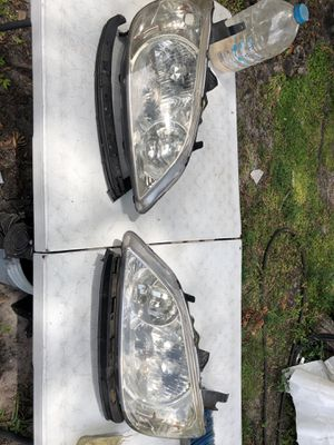 Don't know exactly but believe it's Toyota headlights for Sale in Tampa, FL