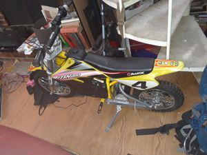 RAZOR MOTORCYCLE MX650 36VOLT/17mph/ 220lb max/ comes with helmet and 36v charger. for Sale in Dallas, TX