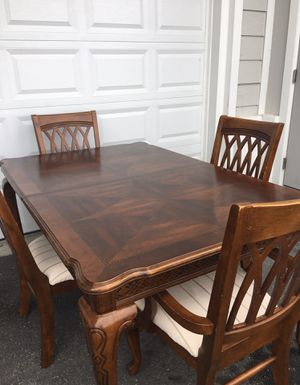 Table and 4 chair solid wood with mirror 3x2 feet for Sale in Davenport, FL