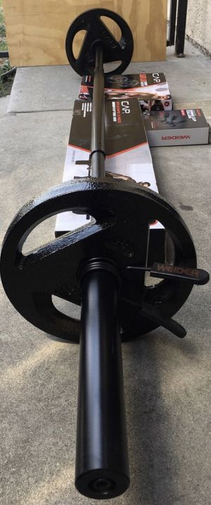 Weights 7ft Olympic bar with a set of 25lb plates for Sale in Covina, CA