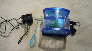 Little aquarium with filter light and food for Sale in Cincinnati, OH