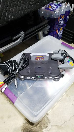 Nintendo 64 was Super Smash Bros one power cord one video cord One controller for Sale in Germantown, MD