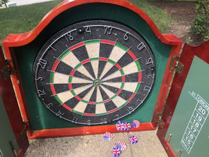 Sturdy bristle Dart board in wood cabinet Highland games for Sale in Canonsburg, PA