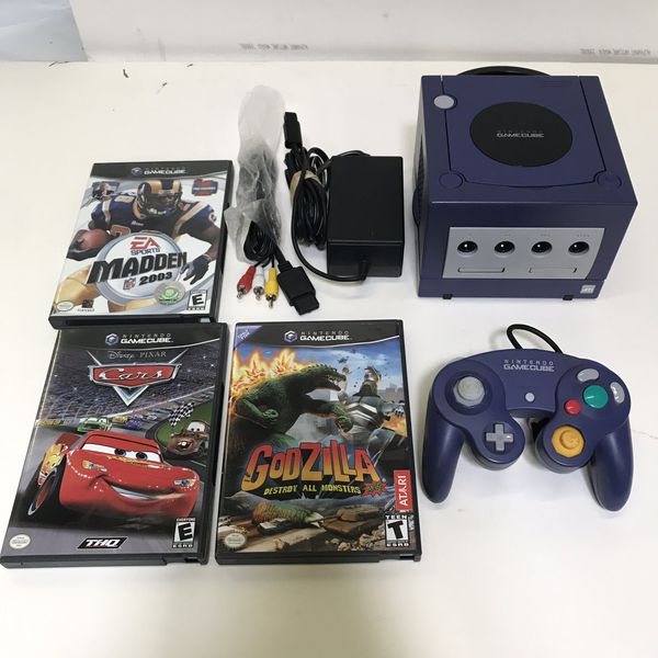 Purple Nintendo Gamecube system console with 3 games and controller