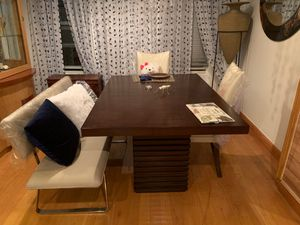 Used, Beautiful wooden table with 2 fat pedestal legs. 2 white chairs .. Only a year old. for Sale for sale  Brooklyn, NY