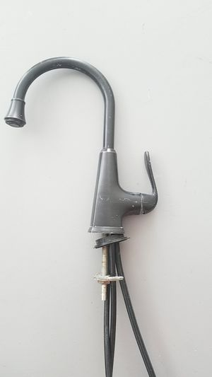 Faucet Price Pfister bronze with sprayer line for Sale in Palmetto, FL