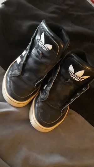 Black and white Adidas for a kid unisex needs shoe laces for Sale in Mesa, AZ