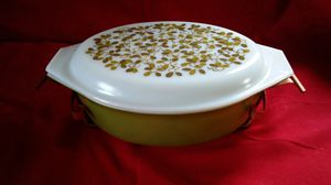 Old Oval Pyrex Casserole Dish with Lid in a Metal Holder for Sale in Seattle, WA