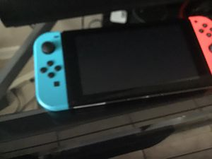 Nintendo switch new with tree games good conditions for Sale in Stafford, TX