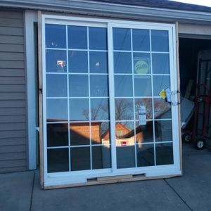 New Patio Doors Pella Slide With Grilles Size w 70.3/4 H 79.1/2 Open From right Slide On The Left Inside The House. $450. for Sale in Chicago, IL