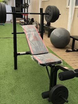 Gym Equipment Adjustable Bench press, barbell, leg developer and 100lbs of weight for Sale in Whittier,  CA