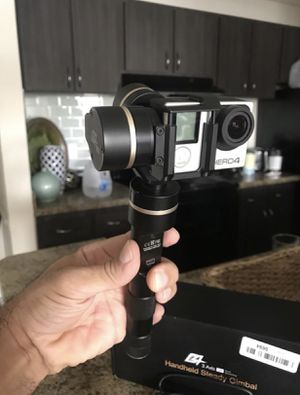 HANDHELD STEADY GIMBAL G4 3 AXIS THIS ITEM IS IN EXCELLENT CONDITION WITH 4 BATTERY'S AND CHARGER AS WELL AS THE BOX. Go pro not included. for Sale in Town 'n' Country, FL