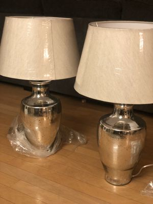 Brand new set of chrome glass tall table lamps. Retails for over $250 for the set for Sale in Fowler, CA