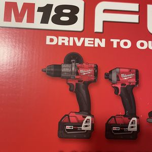 M18 Milwaukee impact driver and hammer drill brand new. for Sale in Schaumburg, IL