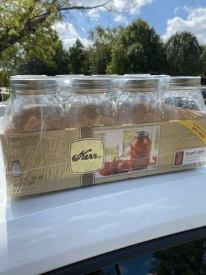 12 count 32oz Glass Mason Jars with Lids and band for Sale in Houston, TX