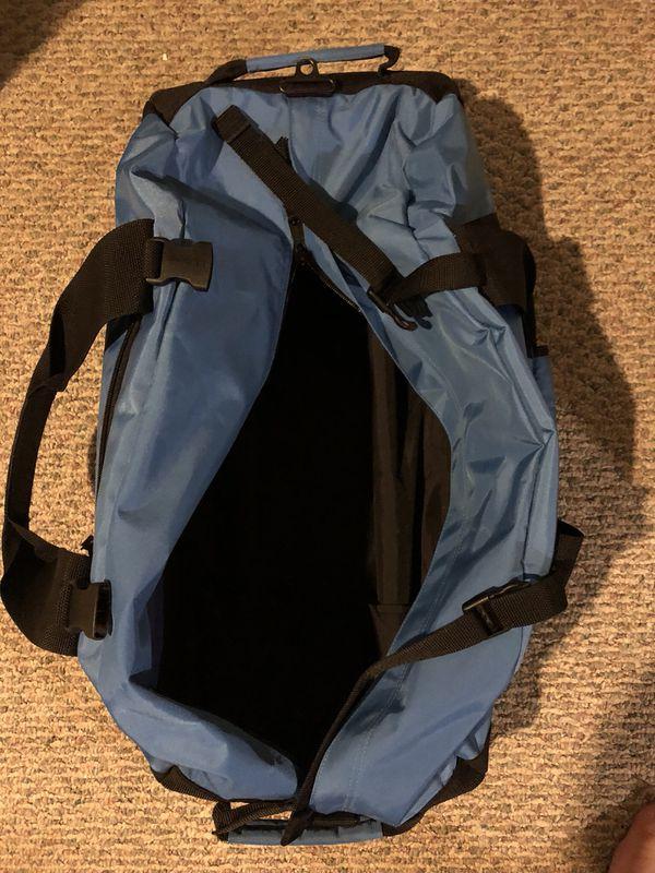LL Bean light blue rolling duffel bag