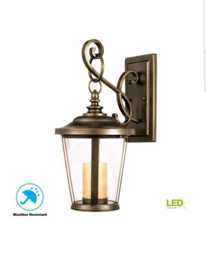 Home Decorators Bellingham Oil-Rubbed Bronze LED Medium Outdoor Wall Mount with Clear and Amber Glass Candle, New, PRICE IS NOT NEGOTIABLE. for Sale in Palatine, IL