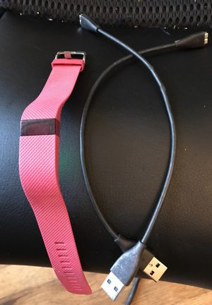 selling a pink fitbit with chargers for Sale in Fresno, CA