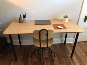 Bamboo office desk with matching light wood swivel chair for Sale in Englewood, CO