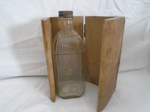 Antique Bottle with a wooden Jacket for Sale in Medical Lake, WA