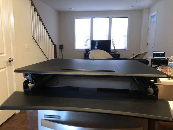 "Staples Sit to Stand Adjustable Desk Riser, 35"""