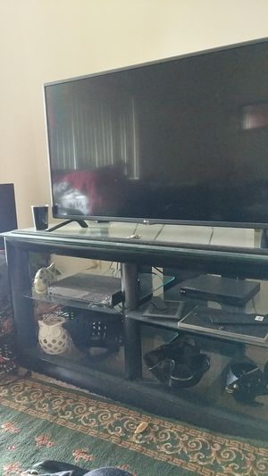 Black entertainment center with glass shelves for Sale in Hilliard, OH