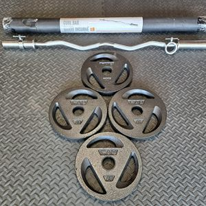 CAP OLYMPIC CURL BAR (SOLD); & 4 -25lb OLYMPIC GRIP PLATES -$125 for Sale in Houston, TX