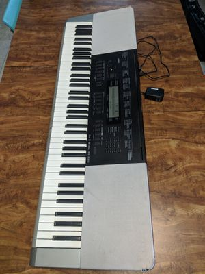 Used Casio WK-220 with power adapter, music stand, keyboard stand for Sale in Seattle, WA