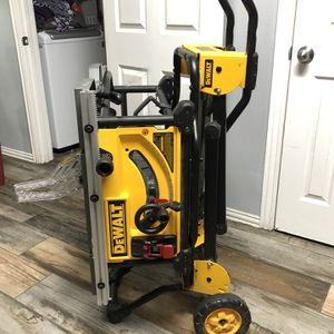 DEWALT 15 Amp Corded 10 in. Job Site Table Saw with Rolling Stand (NEW) for Sale in Arlington, TX