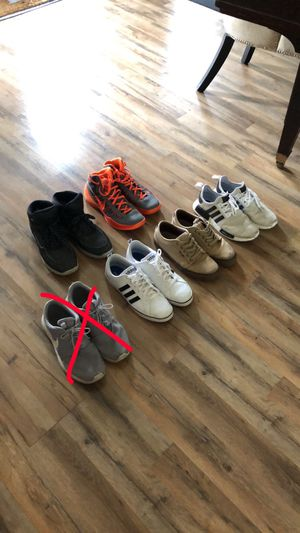 Men's shoes. Size 11's. Orange Nike are size 11 1/2. Vans, Nike, Adidas, Timberlands for Sale in Adrian, MI