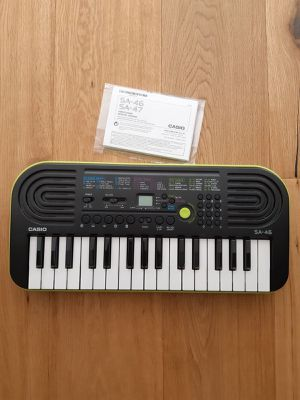Mini keyboard casio green works perfectly for Sale in Seattle, WA