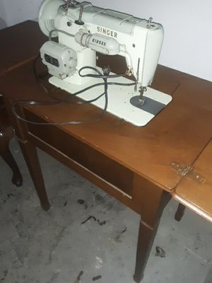 Singer sewing machine with cabinet for Sale in Newark, OH