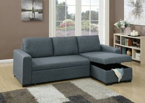 Sectional sofa with pull out bed & storage ottoman blue grey for Sale in Los Angeles, CA
