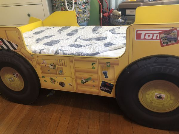 Childs Truck bed with front bookshelf and linens.