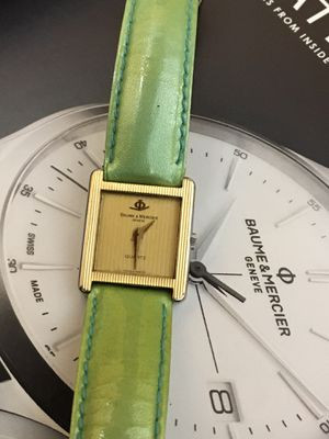 Baume & Mercier, woman's watch. 18k gold and stainless steel. 20x32 mm. Swiss made quartz movement. for Sale in South Miami, FL