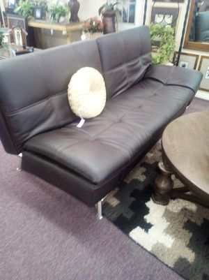 Like New Leather black futon sofa bed adjusts for Sale in Huntington Beach, CA