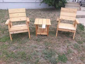 Cedar lawn/patio chair and table set. The set includes two chairs and a table for $165 for Sale in Sioux Falls, SD