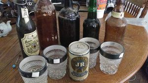 5 antique whiskey and beer bottles 1 can 4 whiskey tumblers for Sale in Abilene, TX