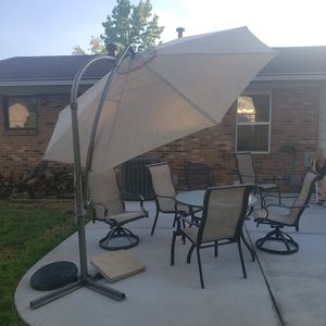 Patio furniture with big umbrella for Sale in Saint Charles, MO