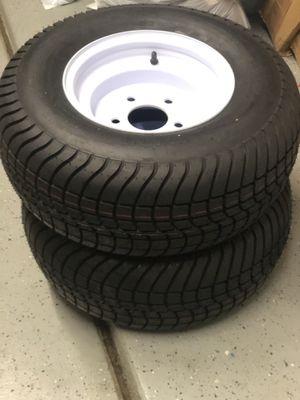 NEW- (2) Kendi Loadstar 205/65-10 Bias Trailer tires w/ 10 in Solid Center Wheel - 5 on 5.5 - LR E Retail $142 each for Sale in Bakersfield, CA