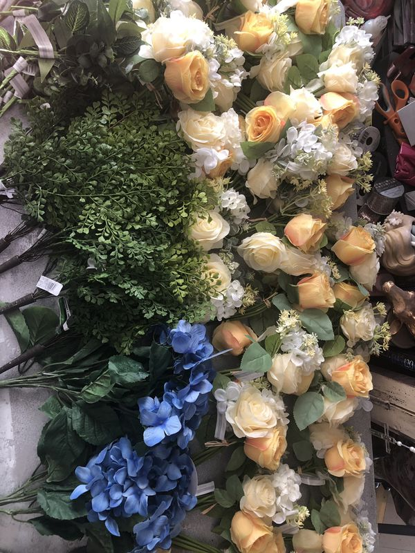 Silk wedding flowers and greenery