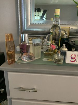 Woman's perfume 9 total 5 almost new other half I have coco Chanel black bottle I don't like the smell almos new make me offer for Sale in Norcross, GA