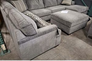 Brand new Ashley U Shape Sectional Sofa and storage ottoman tax included and free delivery for Sale in Hayward, CA
