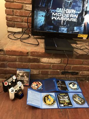 PS4 with 4 games and one controller plus charger for Sale in Bakersfield, CA