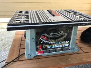 Delta brand bench table top style table saw 10 inch blade for Sale in Stanwood, WA