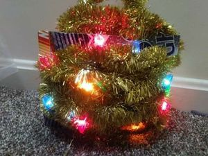 Multi-colored Lighted Gold Garland for Sale in Evansville, IN