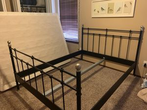 Queen sized metal bed frame with headboard and footboard, great condition, includes middle support for Sale in Ellensburg, WA
