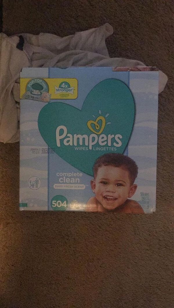 Pampers ,wipes and a baby dove bath set
